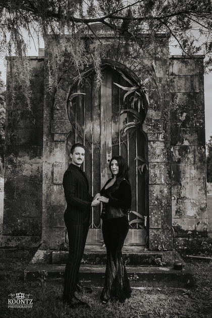 """Addams Family"", ""Morticia and Gomez"", Morticia & Gomez"", ""Famous Couples"", ""Morticia Cosplay"", ""Gomez Cosplay"", ""Adams Family Cosplay"", ""Halloween Engagement"", ""Halloween Wedding"", ""Spooky Engagement"", ""Gothic Engagement"", ""Goth Engagement"", ""Engagement photography"", ""Gothic Couples Portraits"", ""Greenwood Cemetery"", ""Cemetery Engagement Photos"", ""Graveyard Engagement photos"""
